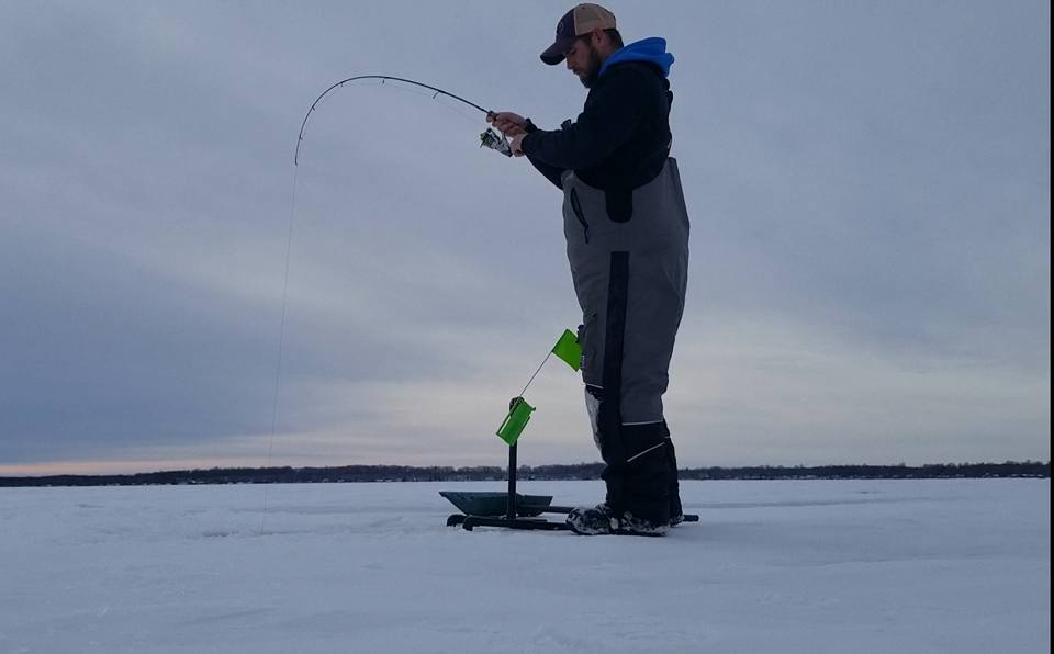 ice fishing with tip down