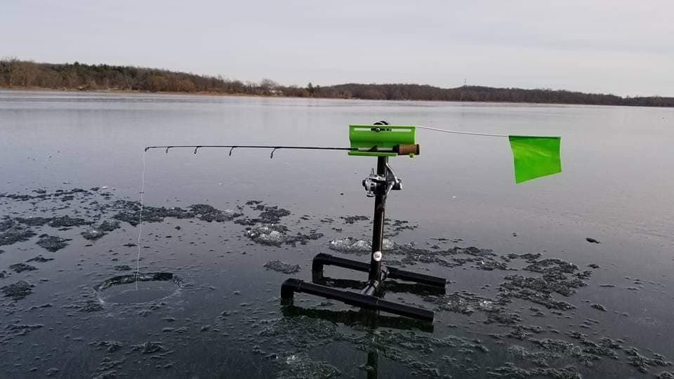 ice fishing with a tip down